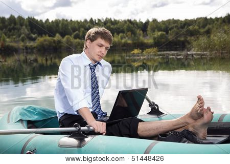 Dressed Man In Boat And Reading