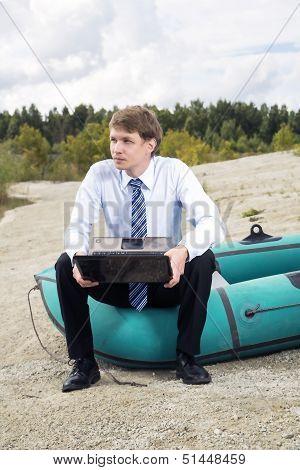 Dressed Man Sit On Boat Edge