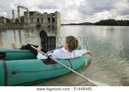 Dressed Man Lay Over Boat On Lake