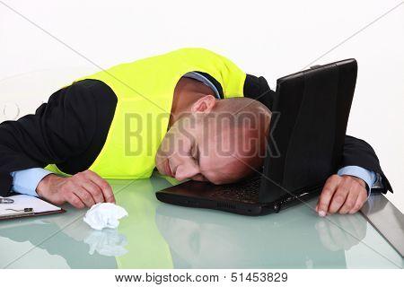 Man sleeping on his laptop