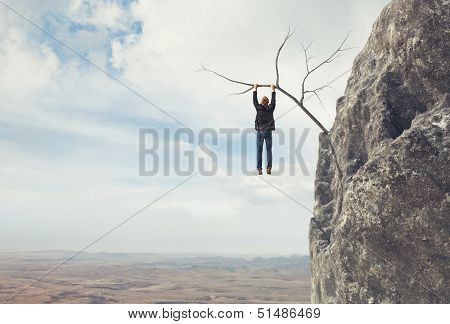 Business man climbs a mountain