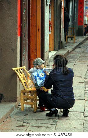 Chinese Woman Feeding Baby