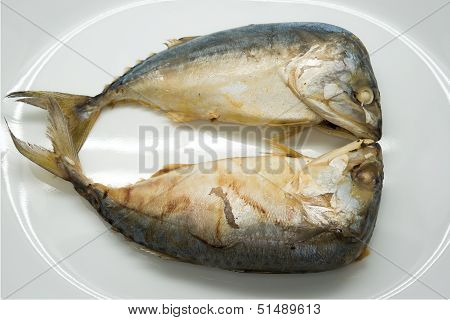 Two steamed mackerel fishes in the plate poster