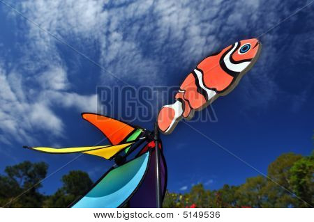 Fish Shape Of A Windmill With Blue Sky