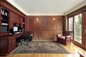 Library and office in luxury home with cherry wood paneling poster