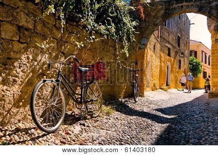 Bicycles in ancient city and tourists