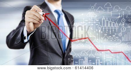 Close up of businessman drawing increasing graph