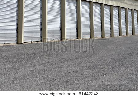 Detail of storage units building with sliding garage style doors