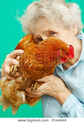 Portrait Of Grandmother With A Cock