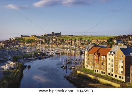 Scenic view of river Esk receding through Whitby town North Yorkshire England poster
