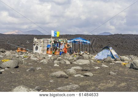 People At A Fishermans Hut  At Volcanic Beach In Timanfaya