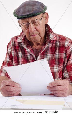 Senior Man Holding Paper