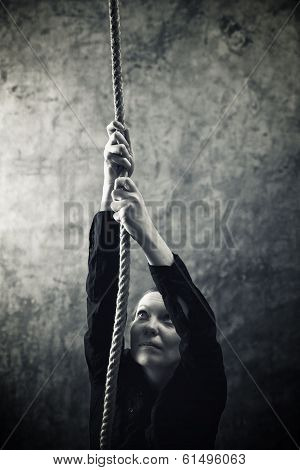 Woman Climbing Up With Rope