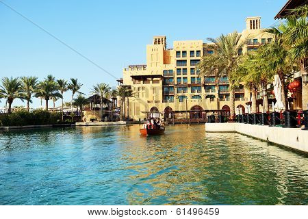 Dubai, Uae - September 9: View Of The Souk Madinat Jumeirah And Tourists Swimming On Abra Boat. Madi
