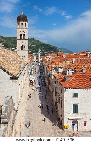 DUBROVNIK, CROATIA - MAY 26, 2014: View on Stradun and the Franciscan Monastery from old city walls. Stradun is 300 meters long main pedestrian street in Dubrovnik.