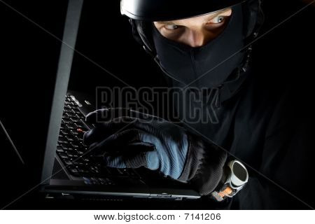 Security Concept With Man And Laptop At Night