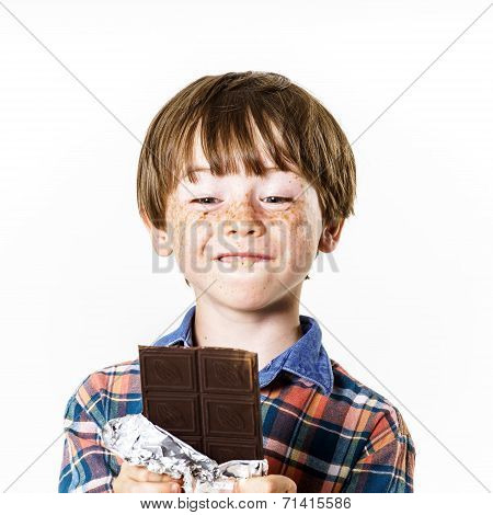 Happy Red-haired Boy With Chocolate Bar