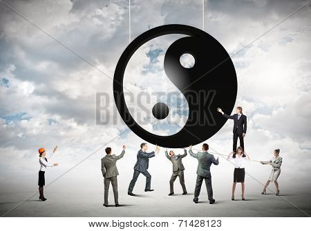 Group of businesspeople and yin yang sign poster