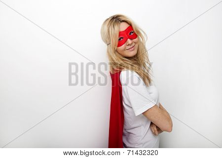 Side view portrait of confident woman in superhero against white background
