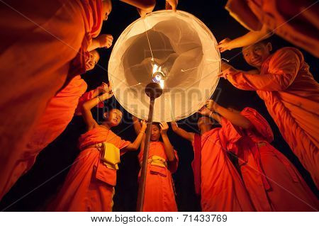Unidentified thai monks fire a floating lamp on November 24, 2012 in CHIANGMAI