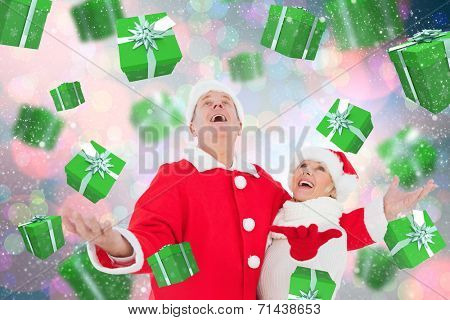 Festive mature couple against light glowing dots on blue poster