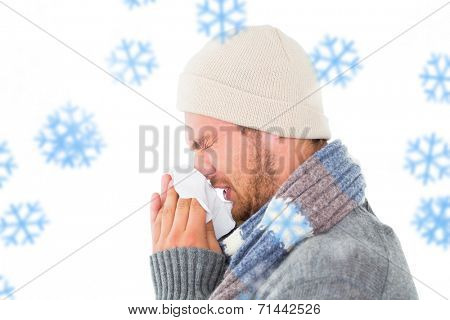 Handsome man in winter fashion blowing his nose against snowflakes poster