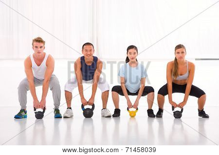 Multiethnic Group Of People Doing Kettlebell Exercise