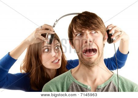 Woman Interupts Man With Headphones