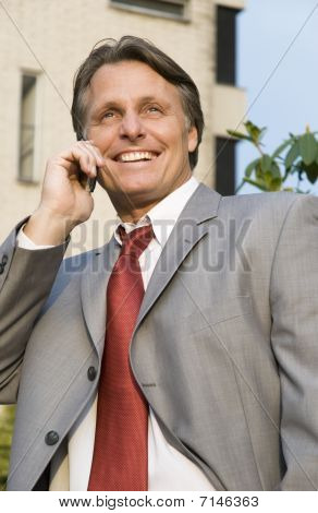 happy businessman on cellphone
