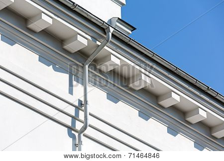 Rooftop rain gutter on house with blue sky background poster