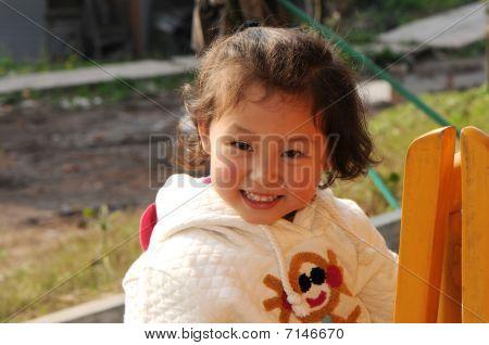 Cute Little Girl In White