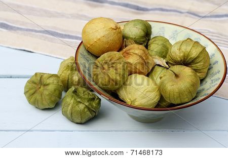 Ceramic bowl of organic green tomatillo