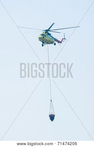 MI-8 helicopter carring water tank for suppression of fire. Russia poster