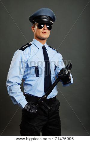 Young policeman poses