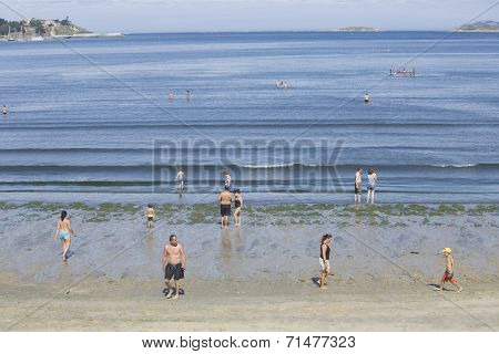 BAIONA, GALICIA, SPAIN - AUGUST 30: people walking at the beach, on August 30, 2014 in Baiona, Galicia, Spain.