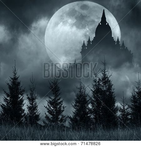 Magic Castle Silhouette Over Full Moon At Mysterious Night. Fantasy Background With Pine Tree Forest
