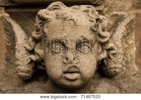 Stone Sculpture Of A Cherub On The Wall