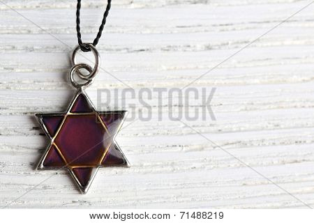 Star David pendant on wooden background poster