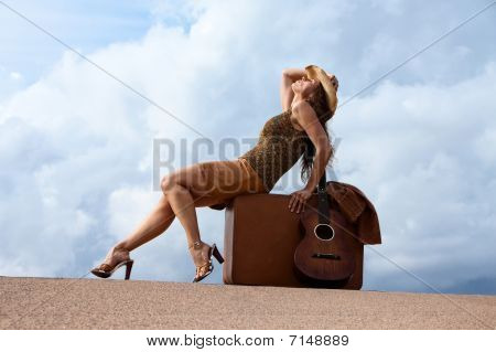 Pretty Woman With Suitcase And Guitar