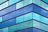 Modern office facade fragment with blue green glass poster