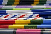 A colourful image of show jumping poles poster