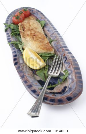 fish dinner on ceramic platter; angled fork