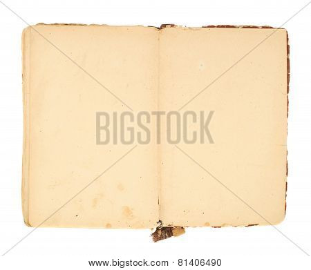 Opened decrepit old book isolated
