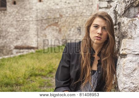 Fashionable young beautiful girl outdoors.