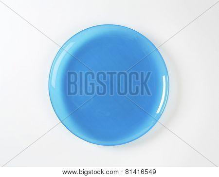 Rimless blue glass dinner plate