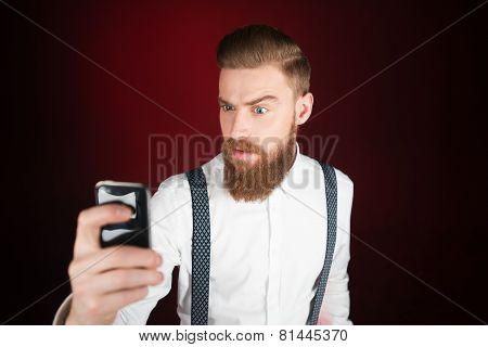 Stylish casual young man with beard making selfie poster