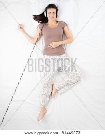 Woman listening to music before sleeping