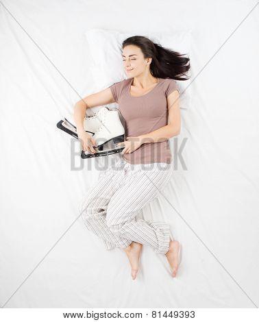 Woman sleeping with racing skates