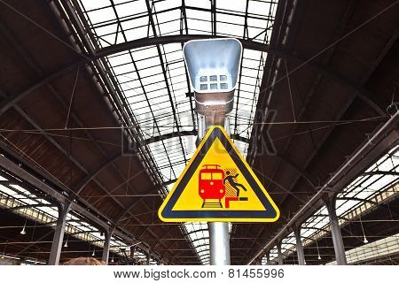 Warning Sign And Speaker In Classicistical Railway Station