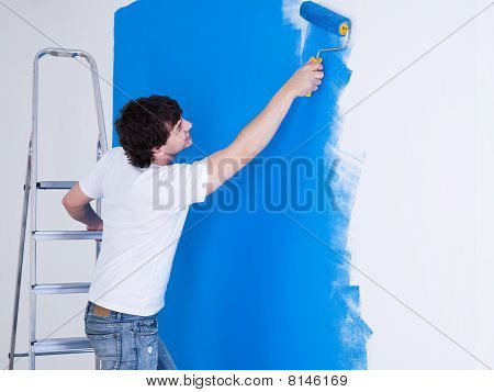 Handsome Man Brushing The Wall